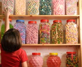 Kid in sweet shop