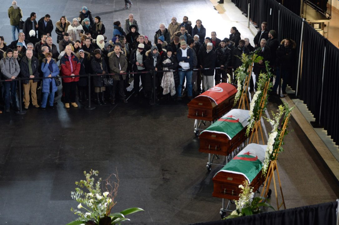 Mourners with caskets