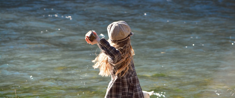 Girl throwing stone